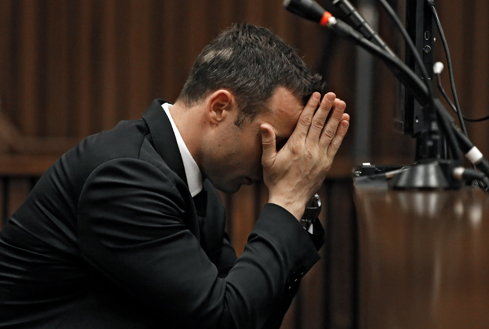 . South African Paralympic athlete Oscar Pistorius, accused of murdering his girlfriend Reeva Steenkamp waits prior to a hearing of his trial at the North Gauteng High Court in Pretoria, on March 5, 2014. (SIPHIWE SIBEKO/AFP/Getty Images)