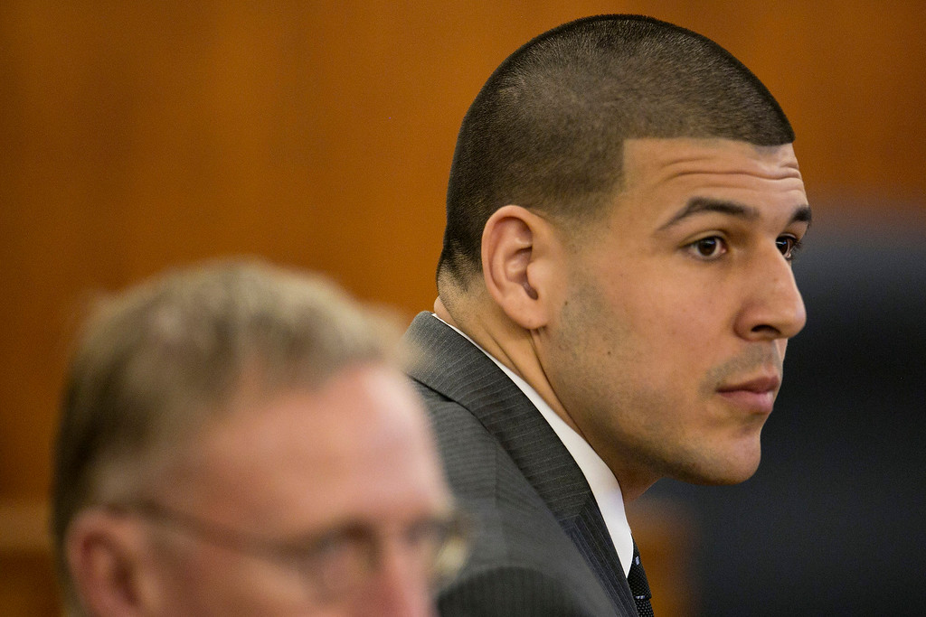 . Former New England Patriots NFL football player Aaron Hernandez listens during his murder trial at the Bristol County Superior Court in Fall River, Mass., on Wednesday, April 15, 2015. Hernandez was found guilty Wednesday of first-degree murder in a deadly late-night shooting, sealing the downfall of an athlete who once had a $40 million contract and a standout career ahead of him. The first-degree murder conviction carries a mandatory sentence of life in prison without parole in the slaying of Odin Lloyd, a 27-year-old landscaper and amateur weekend football player who was dating the sister of Hernandez�s fiancee. (Dominick Reuter/Pool Photo via AP)
