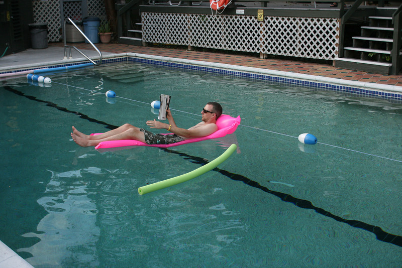 Shane reading in the pool.