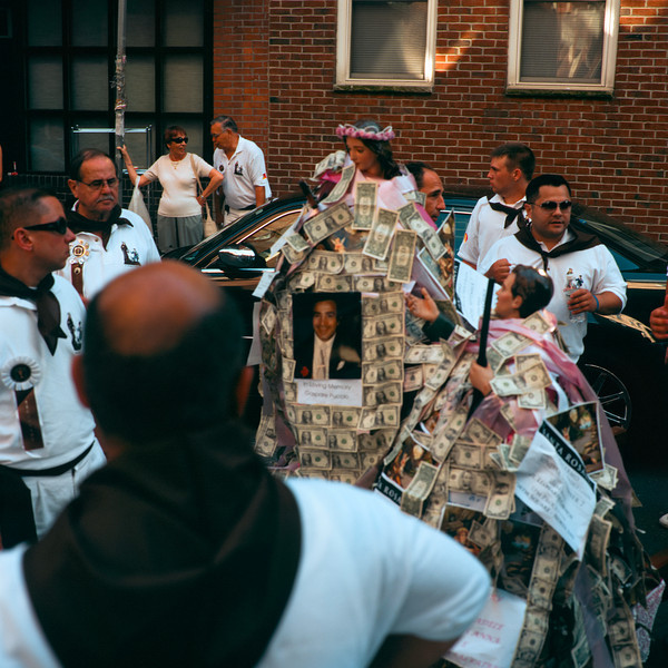 Santa Rosalia Di Palermo Procession - This parade in Boston's North End involves marching two dollar bill covered saints around the neighborhood, while a band follows the around.
