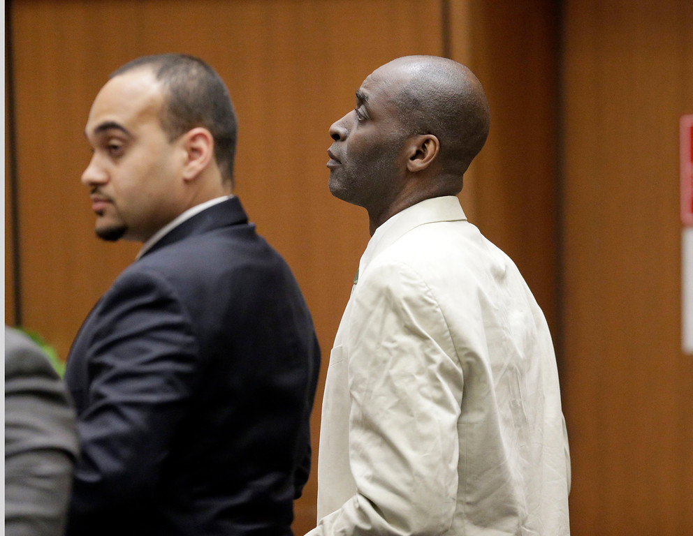 . Actor Michael Jace, right, who played a police officer on television and charged with murdering his wife, listens alongside his attorney Jason Sia during closing arguments during his trial at Los Angeles County Superior in Los Angeles Friday, May 27, 2016.(AP Photo/Nick Ut)