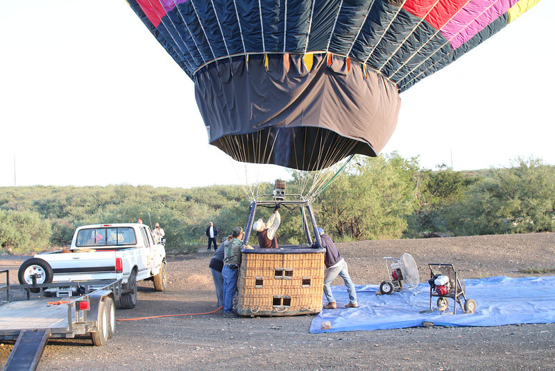 air heated by propane is blown into the balloon