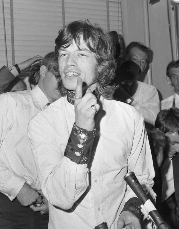 . Mick Jagger, lead singer of the pop group The Rolling Stones, answers questions during a press conference at Granada Studios, London, July 31, 1967. Earlier in the day the Appeal Court had dismissed his appeal against conviction of illegally possessing drugs. (AP Photo/Staff/Rider)