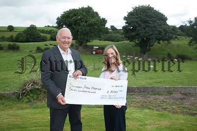 David Brown presents a cheque to Denise Doyle from Souther Area hospice for £700 the proceeds of an Irish Beltex Sheep Breeders Club open night held at Davids farm on the Millvale Road. R1632002