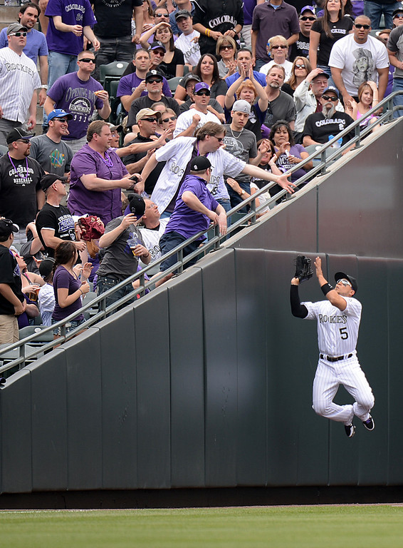 . Carlos Gonzalez (5) of the Colorado Rockies makes a leaping catch on a foul ball in the first inning. (Photo by Hyoung Chang/The Denver Post)