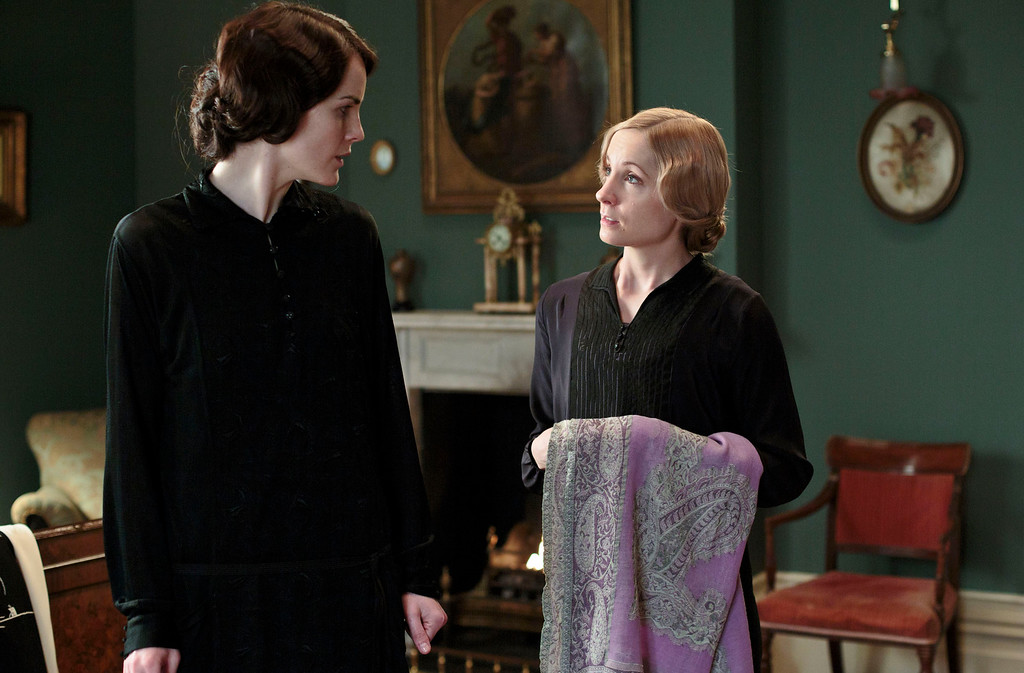 """. This photo released by PBS and Carnival Film and Television Limited shows, Michelle Dockery as Lady Mary, left, and Joanne Froggatt as Anna Bates, in a scene from season four of the Masterpiece TV series, \""""Downton Abbey.\""""Froggatt was nominated for a Golden Globe for best supporting actress in a series, mini-series or TV movie for her role on Thursday, Dec. 11, 2014. The 72nd annual Golden Globe awards will air on NBC on Sunday, Jan. 11. (AP Photo/PBS/Masterpiece, Nick Briggs)"""