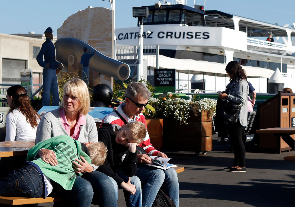 . After traveling from Sweden with their boys, Erik and Axel, Marie and Tony Fredlund look for alternatives after learning their tickets to Alcatraz were no good due to the partial government shutdown that closed the island Tuesday, Oct. 1, 2013. (Karl Mondon/Bay Area News Group)