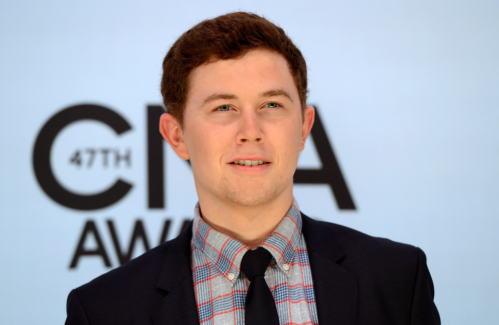 . Scotty McCreery arrives at the 47th annual CMA Awards at Bridgestone Arena on Wednesday, Nov. 6, 2013, in Nashville, Tenn. (Photo by Evan Agostini/Invision/AP)