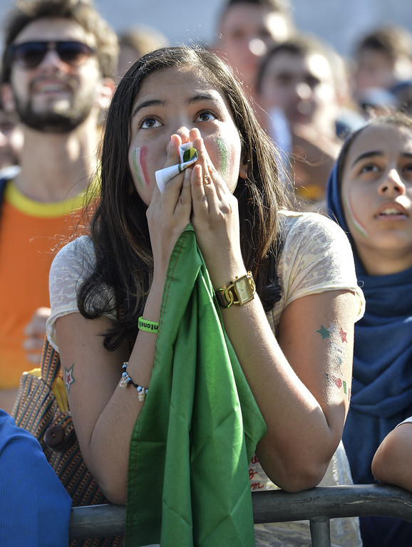 . An Italian fan reacts as she watches on a giant screen the World Cup football match Italy vs Costa Rica on June 20, 2014 on the Piazza Venezia square in Rome. ANDREAS SOLARO/AFP/Getty Images