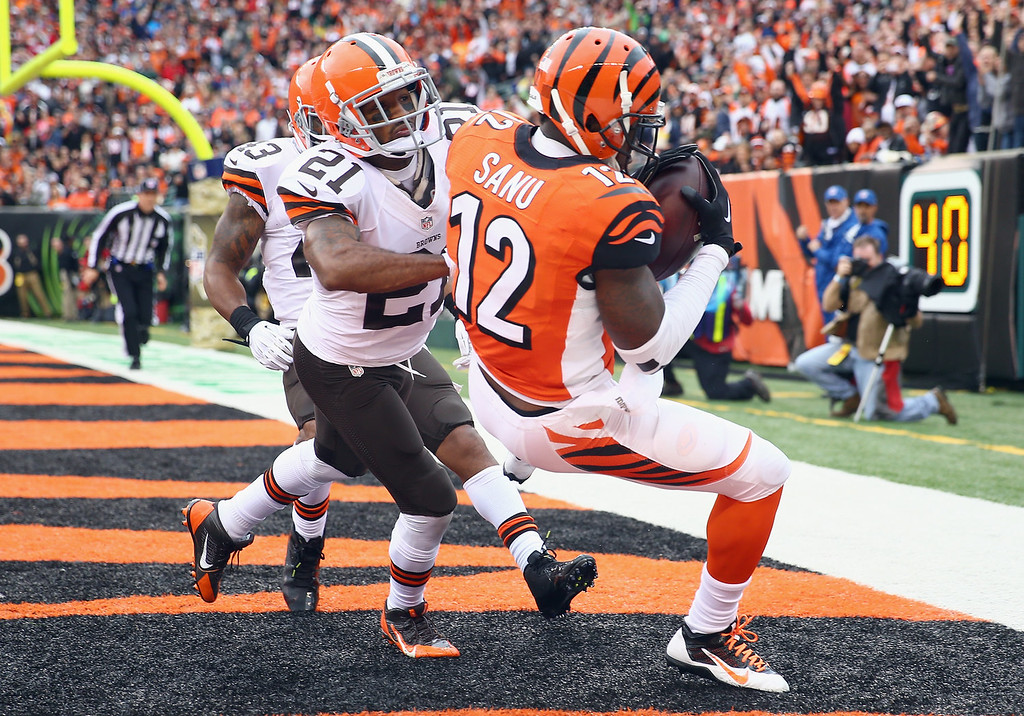 . Mohamed Sanu #12 of the Cincinnati Bengals catches a pass for a touchdown while defended by Chris Owens #21 of the Cleveland Browns during the game at Paul Brown Stadium on November 17, 2013 in Cincinnati, Ohio.  (Photo by Andy Lyons/Getty Images)
