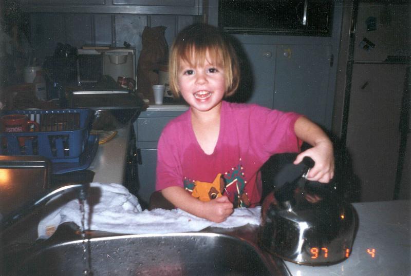Tahirih washing dishes.jpg