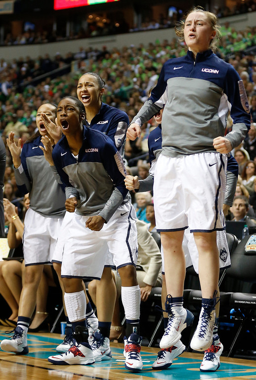 . The Connecticut bench cheers against Notre Dame during the first half of the championship game in the Final Four of the NCAA women\'s college basketball tournament, Tuesday, April 8, 2014, in Nashville, Tenn. (AP Photo/John Bazemore)