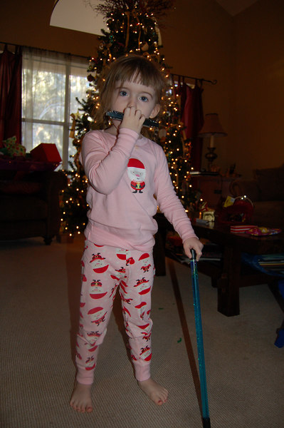 Ainsley with her new harmonica and her baton, which she decided is a walking stick.