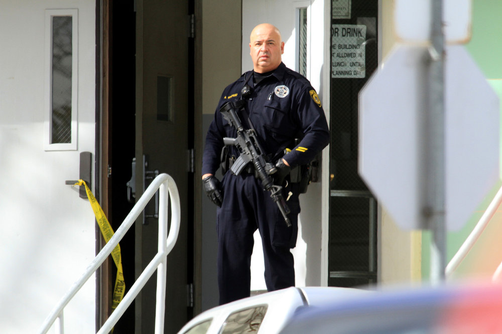 . A law enforcement officer stands guard in front of Taft Union High School in Kern County, California, on Thursday, January 10, 2013, after a student opened fire in a classroom. (Irfan Khan/Los Angeles Times/MCT)