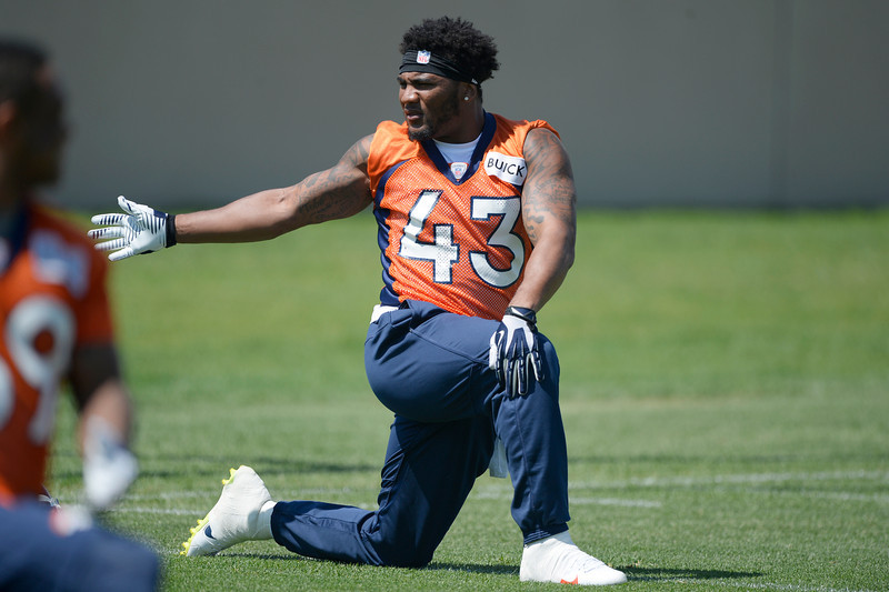 . Denver Broncos T.J. Ward (43) stretches during OTAs June 12, 2014 at Dove Valley. (Photo by John Leyba/The Denver Post)