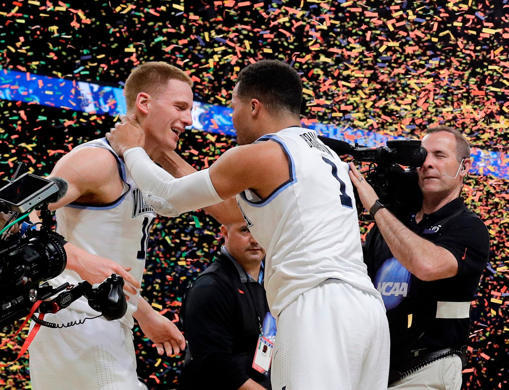 . Villanova\'s Donte DiVincenzo, left, and Jalen Brunson celebrate after the championship game of the Final Four NCAA college basketball tournament against Michigan, Monday, April 2, 2018, in San Antonio. Villanova won 79-62. (AP Photo/David J. Phillip)