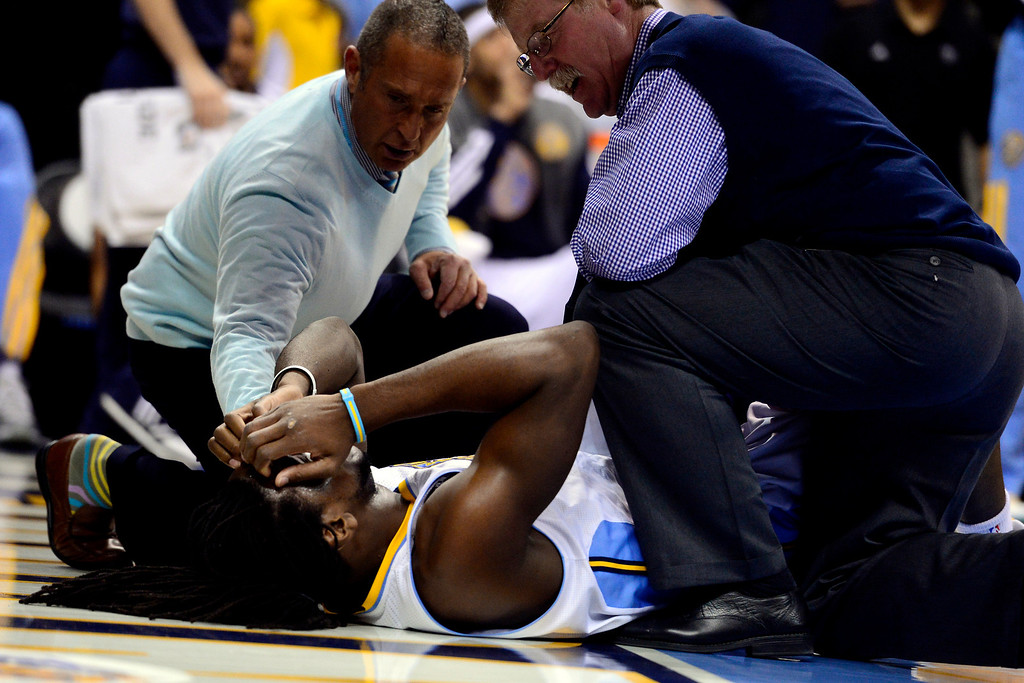 . DENVER, CO - APRIL 14: Kenneth Faried (35) of the Denver Nuggets goes down with an injury during the first half of action. The Denver Nuggets play the Portland Trail Blazers at the Pepsi Center. (Photo by AAron Ontiveroz/The Denver Post)
