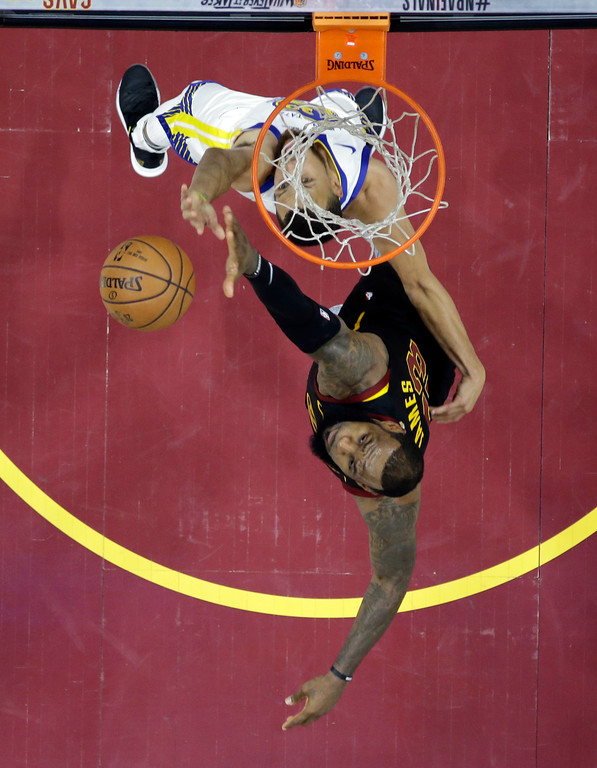 . Golden State Warriors\' Stephen Curry goes to the basket against Cleveland Cavaliers\' LeBron James in the second half of Game 3 of basketball\'s NBA Finals, Wednesday, June 6, 2018, in Cleveland. (AP Photo/Carlos Osorio, Pool)