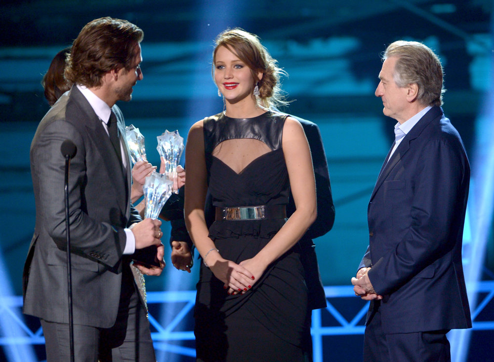 ". (L-R) Actors Bradley Cooper, Jennifer Lawrence and Robert De Niro accept the Best Acting Ensemble Award for ""Silver Linings Playbook\"" onstage at the 18th Annual Critics\' Choice Movie Awards held at Barker Hangar on January 10, 2013 in Santa Monica, California.  (Photo by Kevin Winter/Getty Images)"
