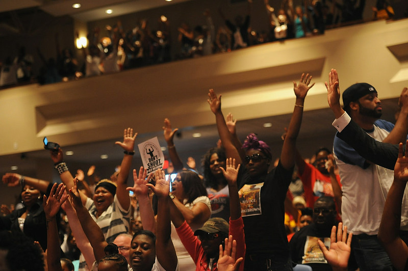 """. Attendees show emotion during a rally in support of Michael Brown Jr., an 18 year-old man killed by a Ferguson Police officer, at Greater Grace Church in Ferguson. The US Justice Department announced that a federal medical examiner would carry out a second autopsy on Brown\'s body, citing the case\'s \""""extraordinary circumstances.\"""" A first one has already been performed.   Michael B. Thomas/AFP/Getty Images"""