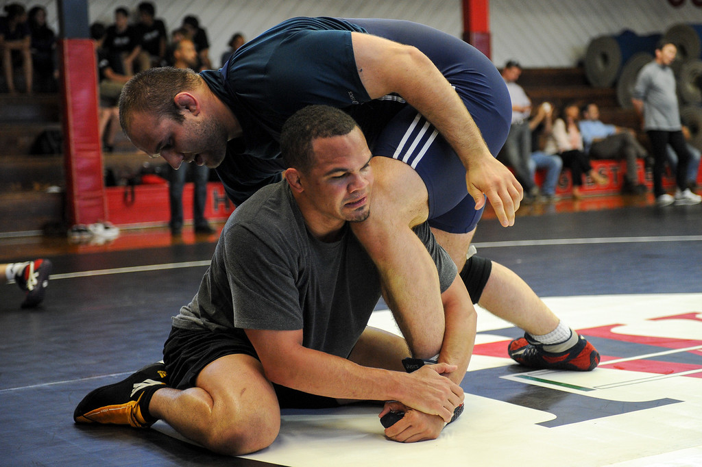 . The U.S. national wrestling team members Chris Pendleton, bottom, and Tervel Dlagnev practice at Harvard-Westlake High School, Friday, May 17, 2013. The USA, Canada and Russia national teams will meet for in exhibition 2:00 p.m. Sunday at L.A. Memorial Sports Arena. (Michael Owen Baker/Staff Photographer)