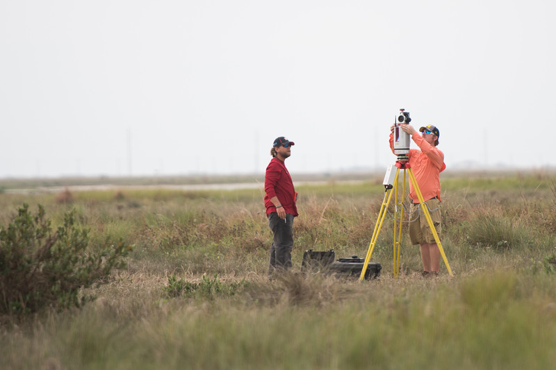 Alistair Lord (left) and Brian Lorentson initialize the LIDAR instrument used during the survey of the Mustang Island area  The Conrad Blucher Institute  collects data following Hurricane Harvey's impact in the coastal bend.