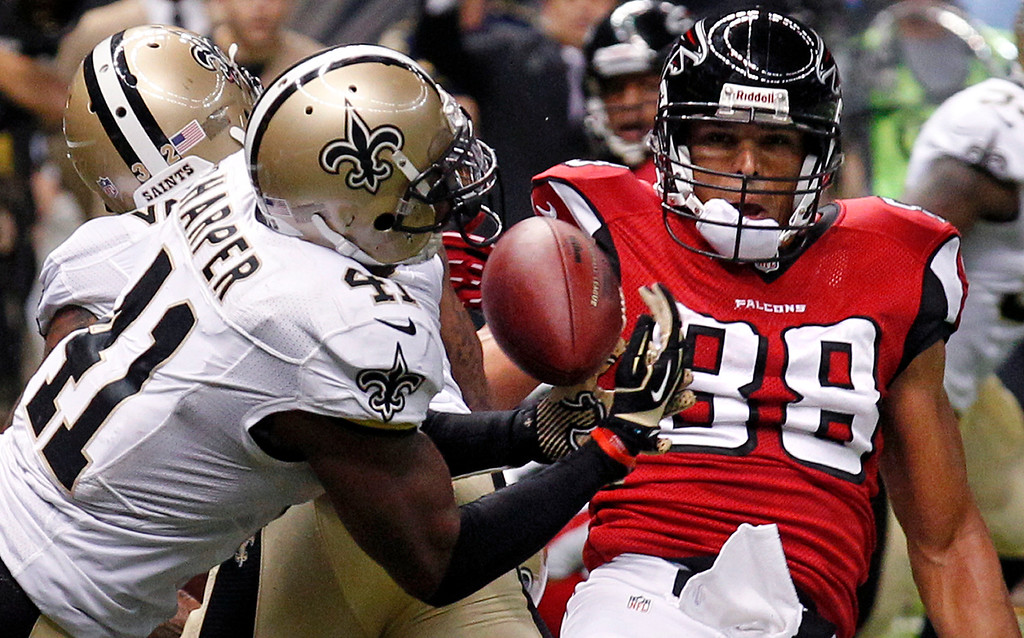 . New Orleans Saints strong safety Roman Harper (41) intercepts a pass in the end zone in the final moments of an NFL football game to seal a win against the Atlanta Falcons in New Orleans, Sunday, Sept. 8, 2013. The Saints won 23-17. (AP Photo/Bill Haber)
