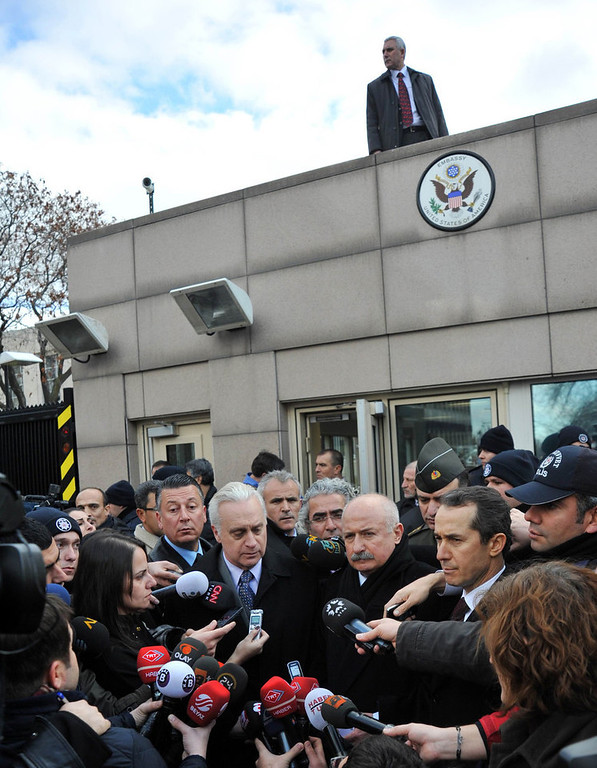 . US ambassador to Turkey Francis J. Ricciardone (C, L) and provincial governor Alaaddin Yuksel (C, R) give a press point on February 1, 2013 at the site of a blast outside the US Embassy in Ankara. A Turkish security guard was killed and several other people wounded in a suicide bombing at the entrance to the highly-fortified US embassy in Ankara on February 1, officials said. The force of the blast damaged nearby buildings in the upmarket Cankaya neighborhood of the capital where many other state institutions and embassies are also located.    AFP PHOTO / ADEM  ALTAN/AFP/Getty Images