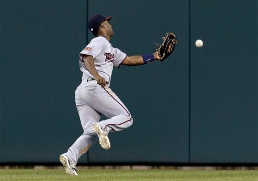 . Minnesota Twins center fielder Danny Santana cannot reach a Detroit Tigers\' Alex Avila double in the seventh inning of a baseball game in Detroit, Friday, June 13, 2014.  (AP Photo/Paul Sancya)