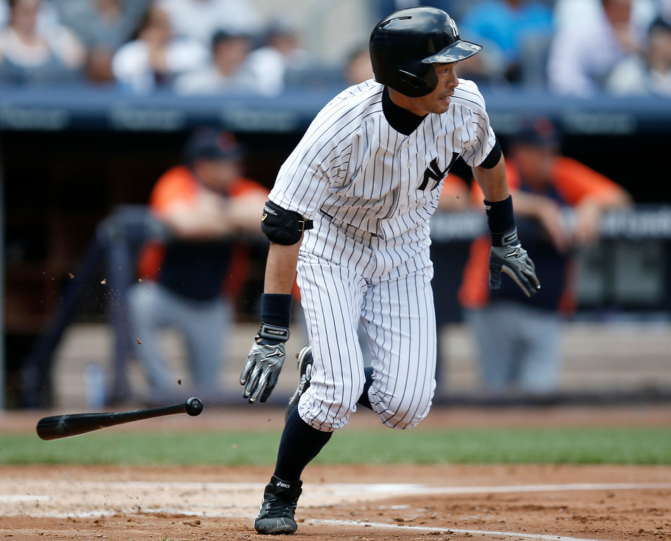 . New York Yankees\' Ichiro Suzuki runs on his third-inning base hit in a baseball game against the Detroit Tigers at Yankee Stadium in New York, Thursday, Aug. 7, 2014.  (AP Photo/Kathy Willens)