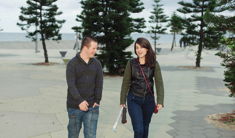 Young Man with Down Syndrome walking with a Young Woman