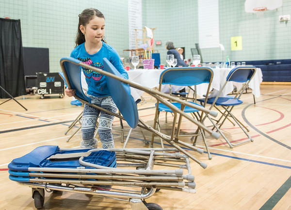 DAVID LIPNOWSKI / WINNIPEG FREE PRESS  6-year-old volunteer Noa Mednikov helps set up chairs at Shabbat  dinner tables at the Rady Jewish Community Centre Friday March 3, 2017 in preparation for a community wide Shabbat dinner where 400 attendees are expected. Winnipeg synagogues are cooperating on this event, and similar events  across Canada and the US are happening on Friday night as well.