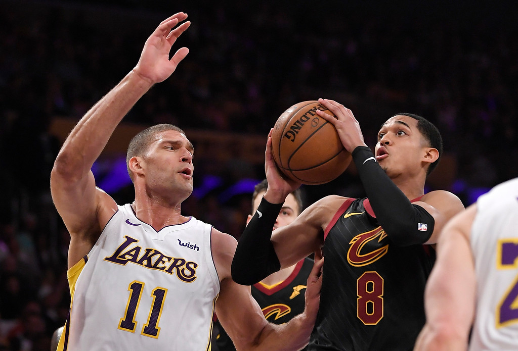. Cleveland Cavaliers guard Jordan Clarkson, right, shoots as Los Angeles Lakers center Brook Lopez defends during the first half of an NBA basketball game, Sunday, March 11, 2018, in Los Angeles. (AP Photo/Mark J. Terrill)
