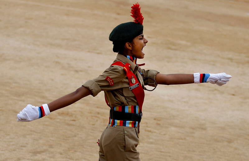 . The leader of a National Cadet Corps contingent gives a command during a parade to mark India\'s Independence Day in Bangalore, India, Thursday, Aug. 15, 2013. (AP Photo/Aijaz Rahi)