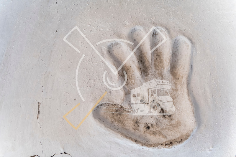 Hand palm print in white clay wall from the kyrgyz hero Kozhomkul at the Kojomkul memorial near Suusamyr