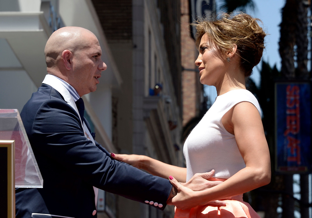 . US actress, singer Jennifer Lopez (R) embraces US rapper Pitbull (L) during Lopez\' star ceremony on the Hollywood Walk of Fame in Hollywood, California, USA 20 June 2013. Lopez was awarded the 2,500th star on the Hollywood Walk of Fame in the category of Recording.  EPA/PAUL BUCK