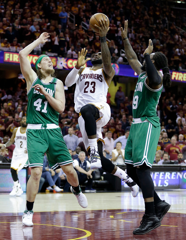 . Cleveland Cavaliers\' LeBron James (23) goes up for a shot between Boston Celtics\' Kelly Olynyk (41) and Jae Crowder during the second half of Game 4 of the NBA basketball Eastern Conference finals, Tuesday, May 23, 2017, in Cleveland. (AP Photo/Tony Dejak)