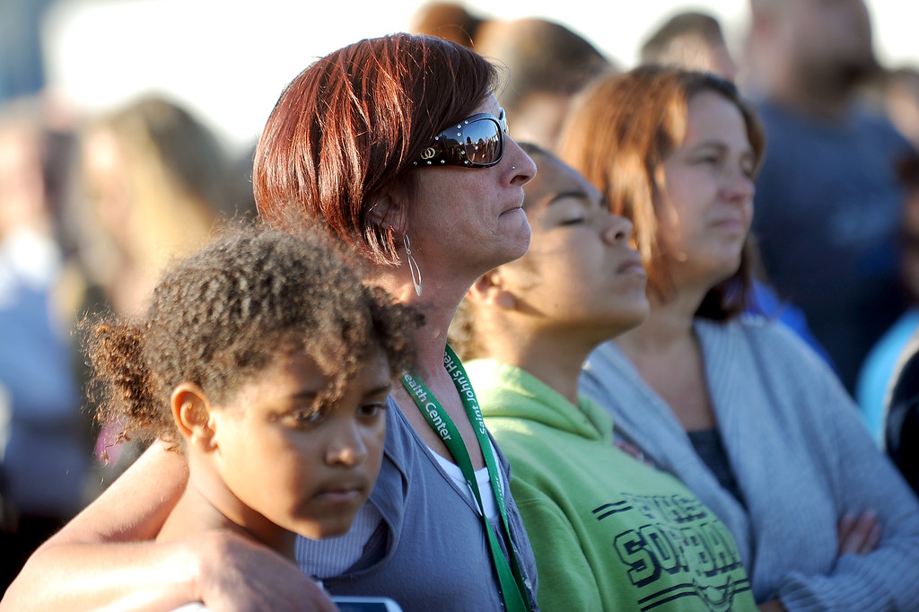 . Mourners including Sherri McCune gather for a vigil at Santa Monica College Monday, June 10, 2013.(Andy Holzman/Los Angeles Daily News)