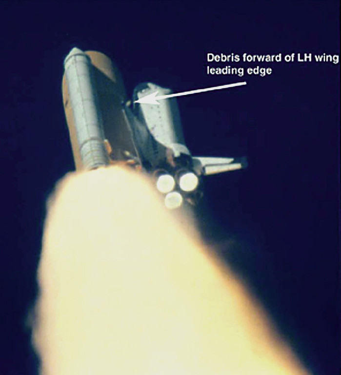 . In this video image released by NASA at the Kennedy Space Center Monday, Feb. 3, 2003, at approximately 80-84 seconds after liftoff of Space Shuttle Columbia on Thursday, Jan. 16, 2003, a large piece of debris is observed striking the underside of the LH wing (left hand wing) of the orbiter.  According to NASA the debris appears to originate from the area of the Y bipod attach point on the external tank. The Y bipod is what connects the external fuel tank to the space shuttle.  NASA\'s immediate study of the image determined no damage to the orbier Thermal Protection System was apparent; further analysis is continuing. (AP Photo/NASA,ho)