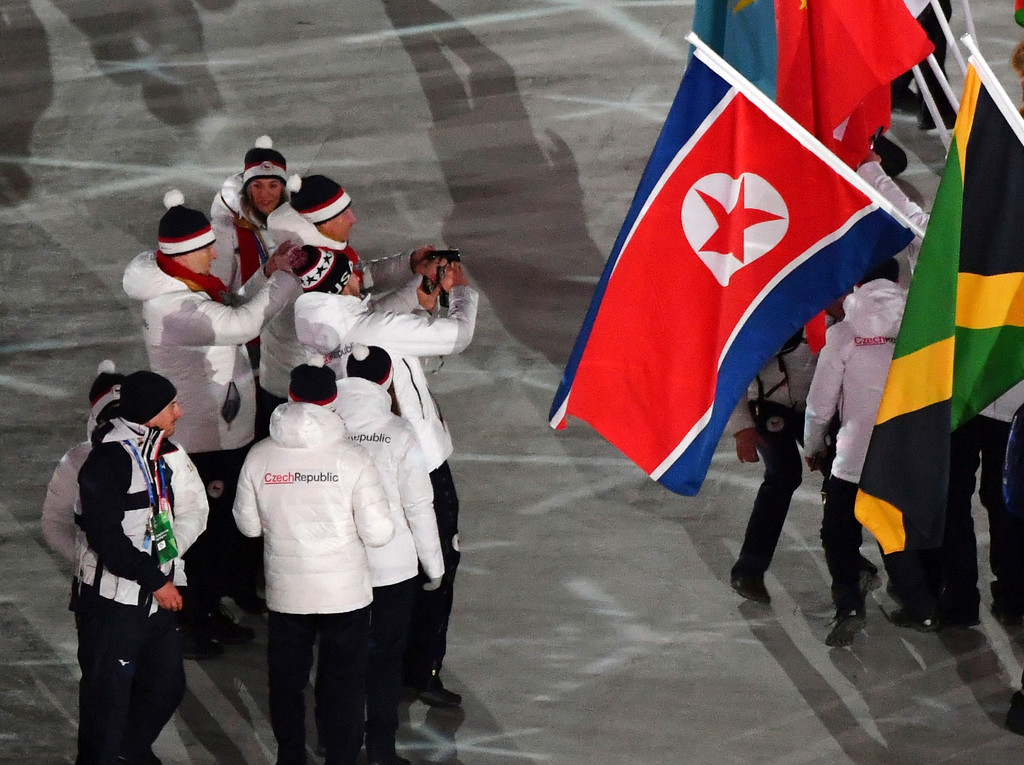 . Members of the Czech Republic team take photos in front of flags, including the flag from North Korea, during the closing ceremony of the 2018 Winter Olympics in Pyeongchang, South Korea, Sunday, Feb. 25, 2018. (Florien Choblet/Pool Photo via AP)