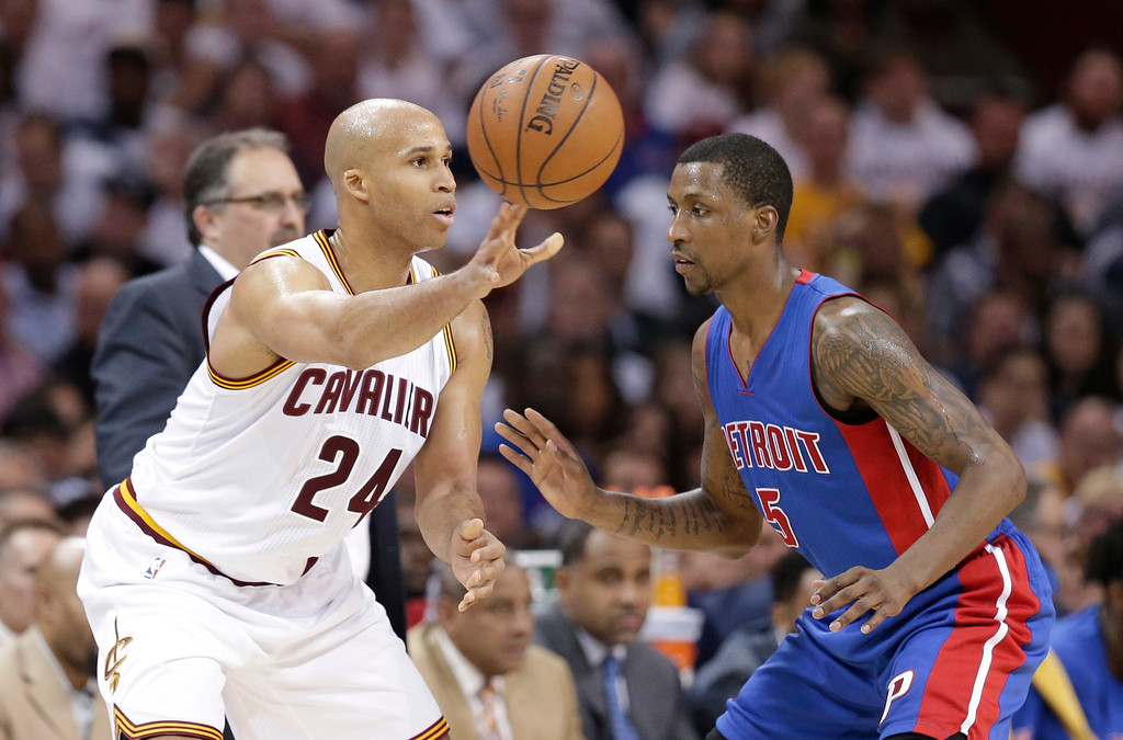 . Cleveland Cavaliers\' Richard Jefferson (24) passes around Detroit Pistons\' Kentavious Caldwell-Pope (5) in the second half in Game 2 of a first-round NBA basketball playoff series, Wednesday, April 20, 2016, in Cleveland. (AP Photo/Tony Dejak)