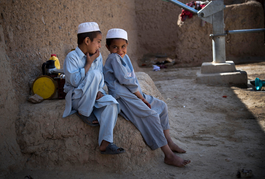 . Naseebullah, left, and Azatullah sit together in the outskirts of Kandahar, Afghanistan on Saturday, April 20, 2013. In an interview, their mother, Masooma, recounted the events of a pre-dawn last year when a U.S. soldier rampaged through two villages killing 16 people, including their father. (AP Photo/Anja Niedringhaus)
