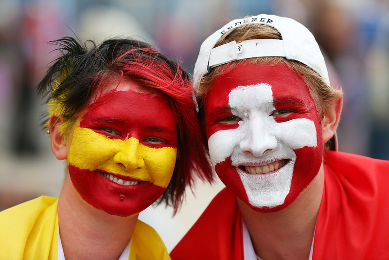 . Tennis fans with their face painted in the flags of Spain and Switzerland pose for photos ahead of the semifinal match between Roger Federer of Switzerland and Rafael Nadal of Spain during day 12 of the 2014 Australian Open at Melbourne Park on January 24, 2014 in Melbourne, Australia.  (Photo by Chris Hyde/Getty Images)