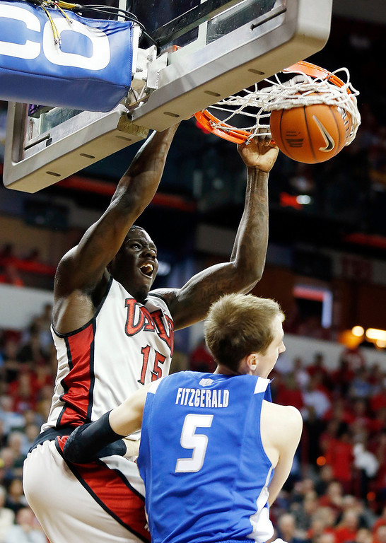 . UNLV\'s Anthony Bennett dunks over Air Force\'s Mike Fitzgerald during the second half of a Mountain West Conference tournament NCAA college basketball game, Wednesday, March 13, 2013, in Las Vegas. UNLV defeated Air Force 72-56. (AP Photo/Isaac Brekken)