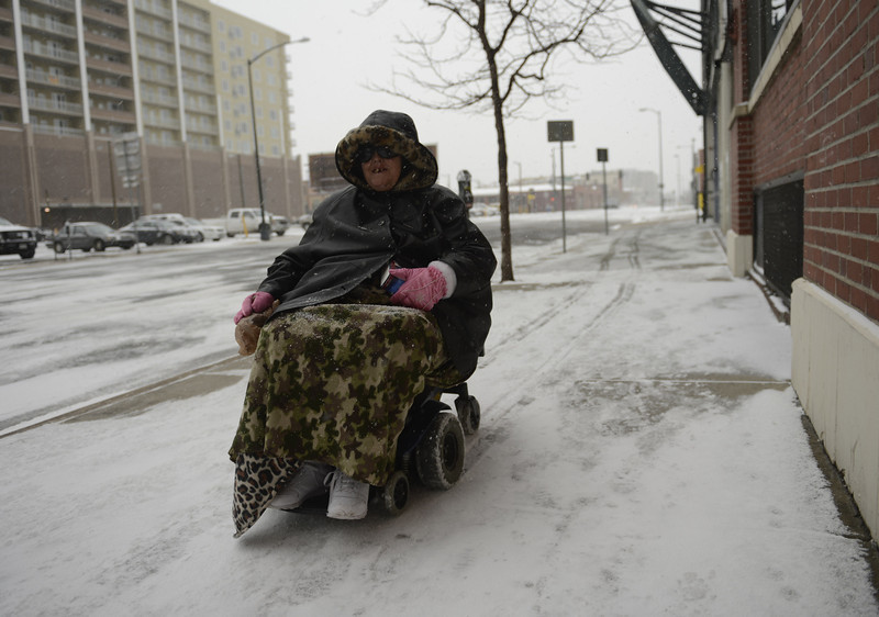 ". Diana Milne crusing down Arapahoe in downtown Denver. ""I\'m going to my bestfriends house,\"" she said. I\'m not going as fast as I usually go cause it\'s just to darn slick.\"" April 09, 2013 Denver, Colorado. (Photo By Joe Amon/The Denver Post)"