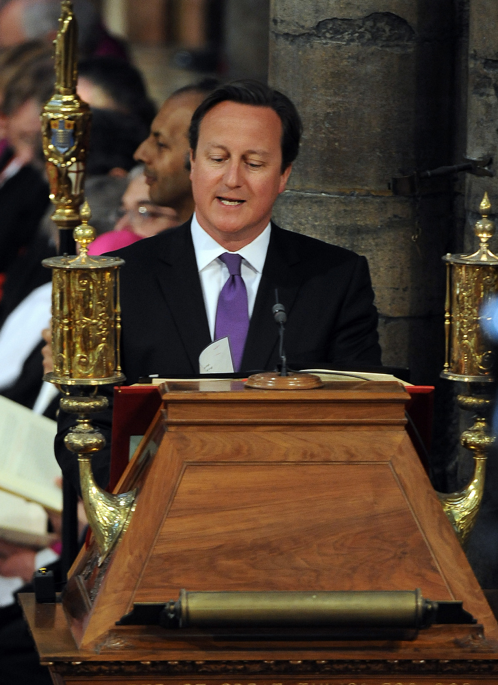 . Britain\'s Prime Minister David Cameron gives a reading from the bible during the service to celebrate the 60th anniversary of the Coronation of Queen Elizabeth II at Westminster Abbey in London on June 4, 2013.   Queen Elizabeth II marked the 60th anniversary of her coronation with a service at Westminster Abbey filled with references to the rainy day in 1953 when she was crowned.  Anthony Devlin/AFP/Getty Images