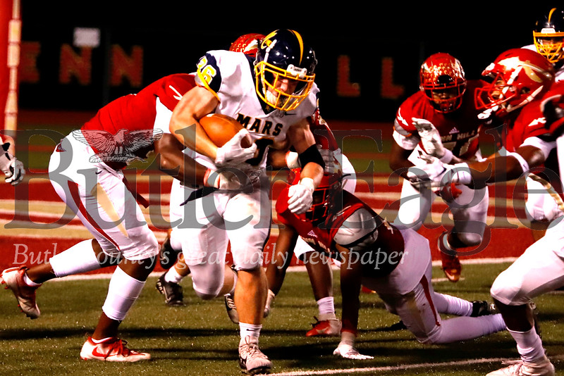 Mars running back Teddy Ruffner (36) pushes forward on a third quarter run deep in their own territory. The Planets started the drive pinned inside the 5-yard-line after a Penn Hills punt. Mars fell to Penn Hills 14-7 after allowing a big late game run for a touchdown. Seb Foltz/Butle Eagle
