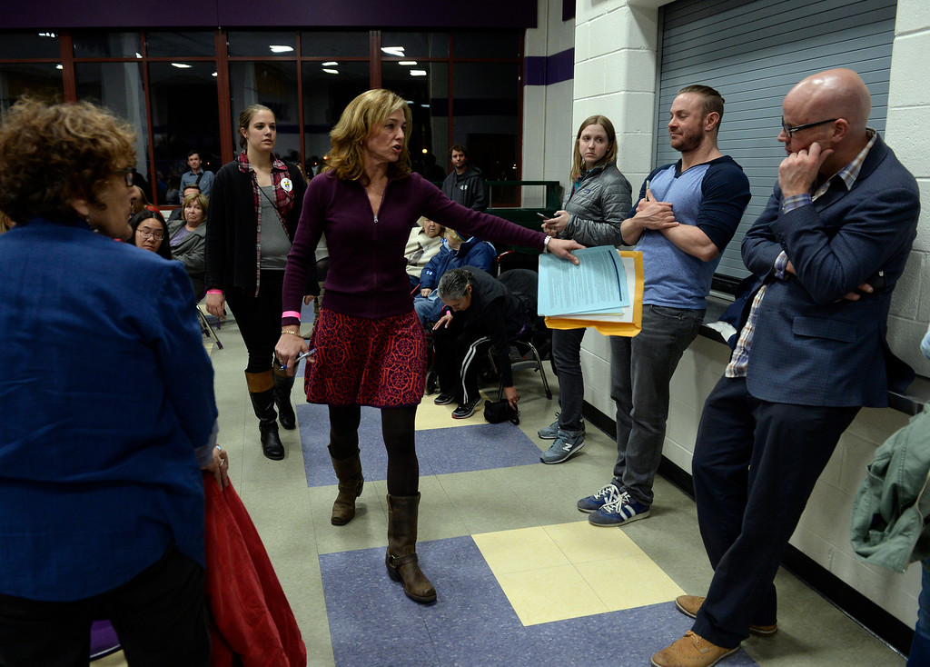 . DENVER, CO - MARCH 1: Adrienne Greene circles the room taking a head-count of Hillary Clinton supporters in Precinct 415. Denver Democrats gather at North High School to participate in the Colorado Democratic Precinct Caucuses. (Photo by Kathryn Scott Osler/The Denver Post)