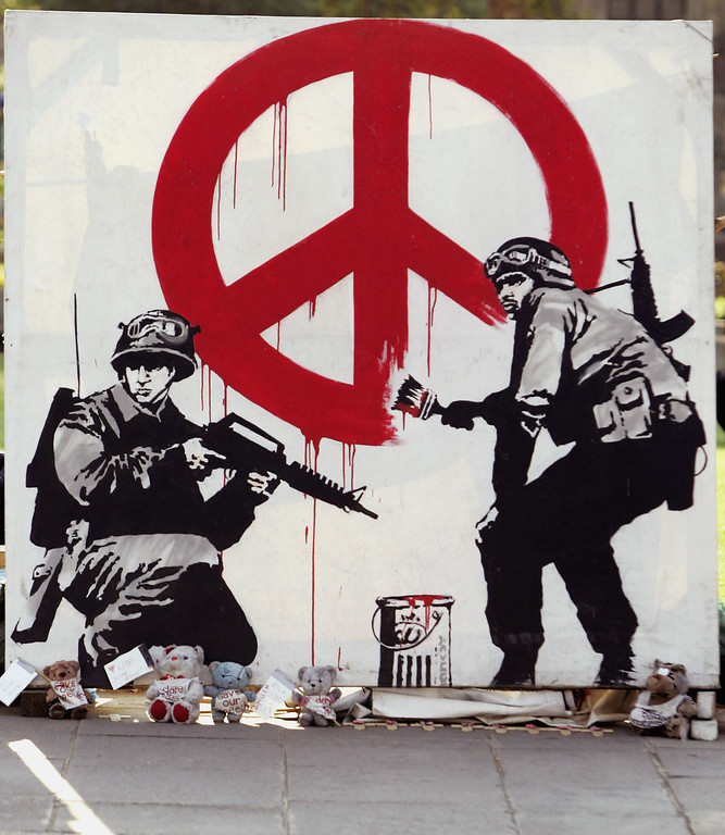 . A artwork by British graffiti artist Banksy is seen as part of Brian Haw\'s peace protest outside the Houses of Parliament on May 11, 2006 in London.  The government won an appeal on monday against a ruling allowing Mr Haw to continue his five year long peace protest outside the Houses of Parliament.  (Photo by Bruno Vincent/Getty Images)