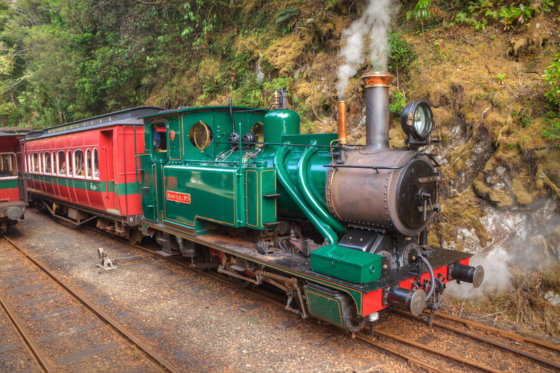 On the West Coast Wilderness Railway (WCWR) between Strahan and Queenstown, Tasmania, Australia. At Dubbill Barrill, meeting another engine and train on a sidetrack going in the opposite direction. The WCWR is a reconstruction of a portion of the Mount Lyell Mining & Railway Company.